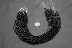 Beads,  crystal Bicone 3mm 12 in. long strand Black in color