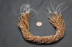 Beads,  Crystal Bicone 3mm 12 in. long strand Dark gold in color