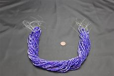 Beads,  Crystal Bicone 4mm 19 in. long strand Dark blue in color
