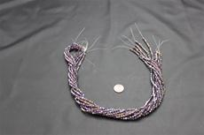 Beads,  Crystal Bicone 4mm 19 in. long strand Purple in color