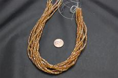 Beads,  Crystal Round 2mm 15 in. long strand Dark gold in color