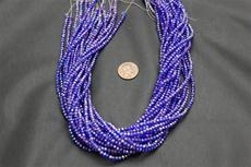 Beads,  Crystal Round 2mm 15 in. long strand  Dark blue in color