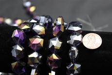 Beads,  Crystal octagon shape. 7 1/2 in. long strand 14mm octagon 8.4 mm thick purple in color