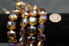 Beads,  Crystal octagon shape. 7 1/2 in. long strand 14mm octagon 8.4 mm thick dark gold in color
