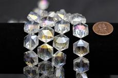 Beads,  Crystal octagon shape. 7 1/2 in. long strand 14mm octagon 8.4 mm thick clear in color