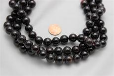 "Red garnet beads. 13mm diameter 15"" long strands 1 strand @ $7.99"