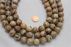 Feldspar beads.round 16.3 mm diameter. 16 1/2 long strand 1 strand for $7.99