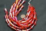 Beads,  Crystal cone.9in. long strand cone size 19mm long 3.2mm x 10mm in in diameter .red in color