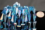 Beads,  Crystal cone.9in. long strand cone size 19mm long 3.2mm x 10mm in in diameter  turquoise in color