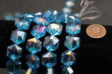 Beads,  Crystal octagon shape. 7 1/2 in. long strand 14mm octagon 8.4 mm thick turquoise in color