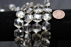 Beads,  Crystal octagon shape. 7 1/2 in. long strand 14mm octagon 8.4 mm thick light smoke in color
