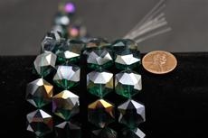 Beads,  Crystal octagon shape. 7 1/2 in. long strand 14mm octagon 8.4 mm thick dark green in color