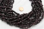 "Beads,  Red garnet nugget.  15"" long strands"