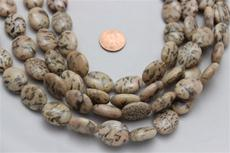 "Feldspar beads.oval 20 mm high 16.2mm wide 8mm thick.15 1/2"" long strands 1 strand for $7.99"