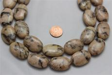"Feldspar beads.oval 30 mm high 20mm wide 8mm thick.15"" long strands . 1 strand for $7.99"