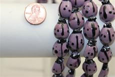 "Beads, Glass  ladybug shape.9"" long strands. 20mm long 14.5mm wide 8.5mm thick. 1 strand for $4.99"